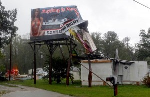 An outdoor advertising sign and several mobile homes were damaged by winds in New Bern, N.C. on Saturday, Aug. 27, 2011 as Hurricane Irene hits the North Carolina coast. (AP Photo/Chuck Burton)