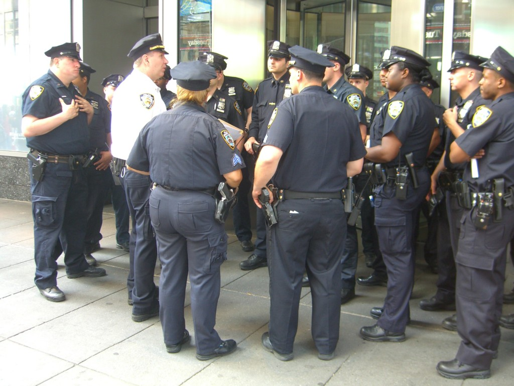 New York City Police officers being debriefed by their lieutenant (in the white shirt) in Times Square, May 29, 2010.  Photo by Luigi Novi.