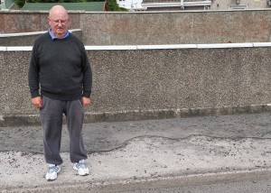 From the Evening Echo: Local resident Maurice Phelan, near one of the footpaths in need of repair on McDonagh Road, Ballyphehane. Picture: David Keane.